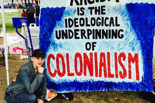 kc-posing-with-anti-colonialism-banner